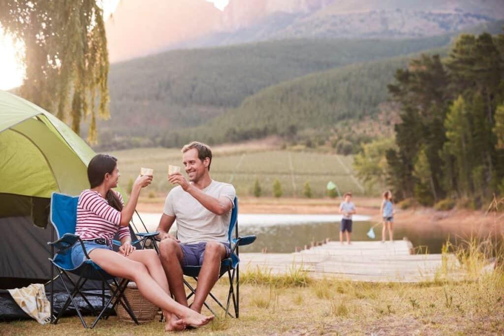 family enjoying camping trip in nice weather