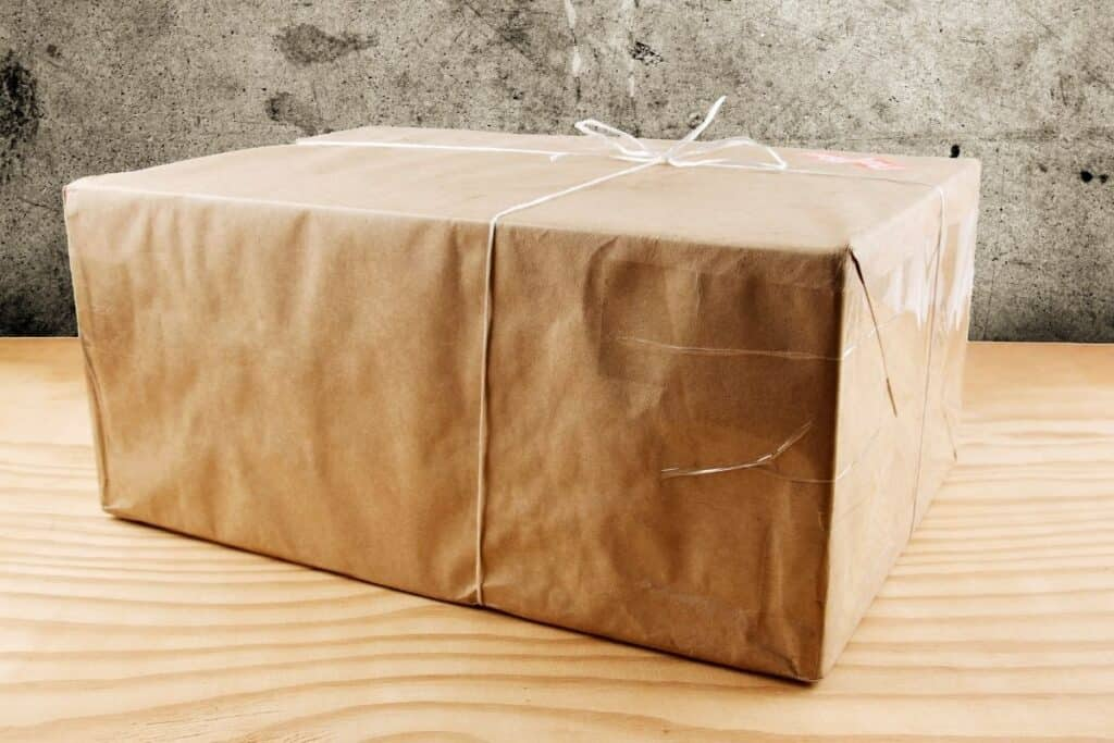 brown paper wrapped package sitting on table