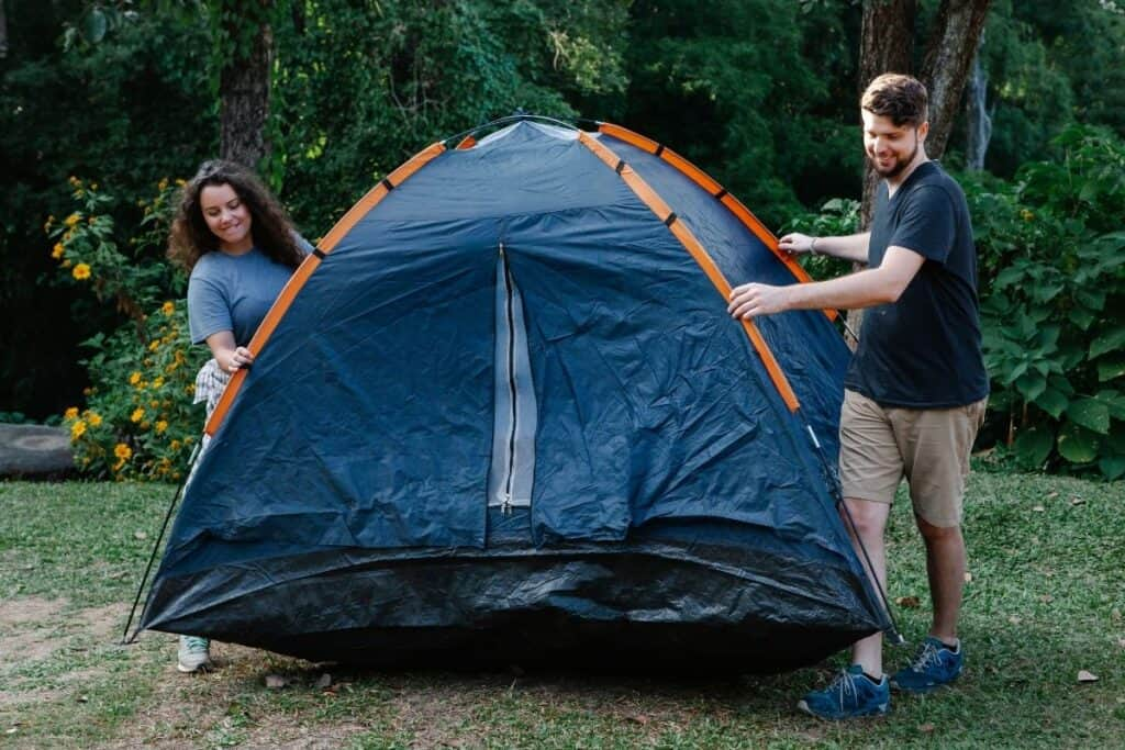 couple pitching tent