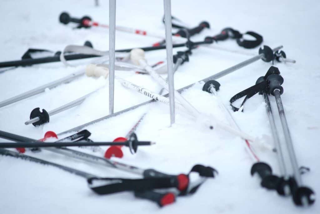 collection of ski poles laying on ground